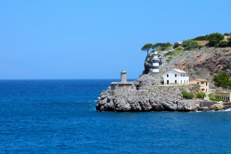 Lighthouse on the rock in Port de Soller, Mallorca photo