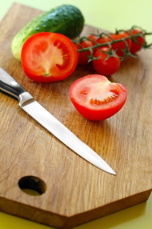 cutting vegetables: vegetables and knife on wooden cutting board Stock Photo