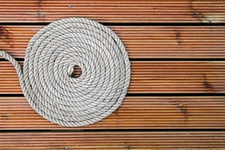 rope on wooden yacht deck photo