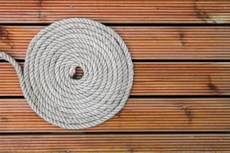 rope on wooden yacht deck Reklamní fotografie