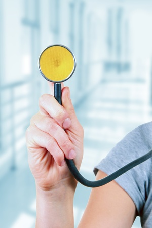 medical services: nurse with a stethoscope in the hands Stock Photo