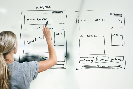 web design company: designer drawing website development wireframe