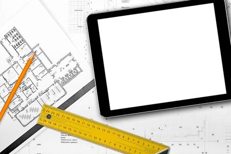 architect tools: blank tablet and tools on house project blueprints