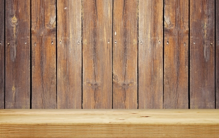 empty shelf on brown wooden plank wall photo