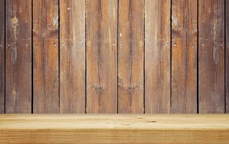 empty shelf on brown wooden plank wall Stock Photo - 23069636