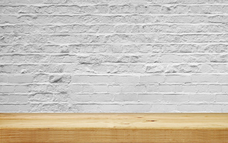 empty shelf on white brick wall photo