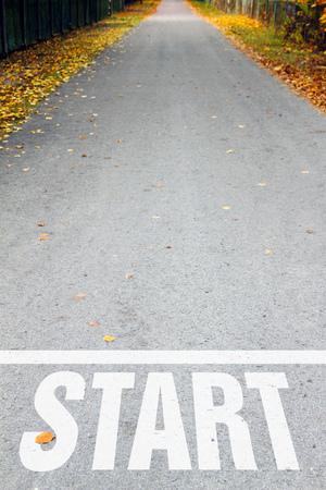 new direction: asphalt road with white start sign