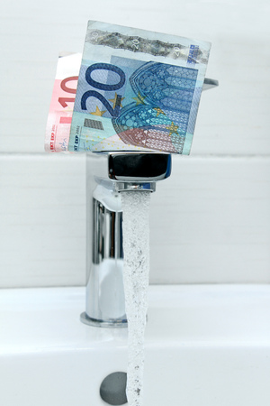 euro money on the tap and flowing water photo