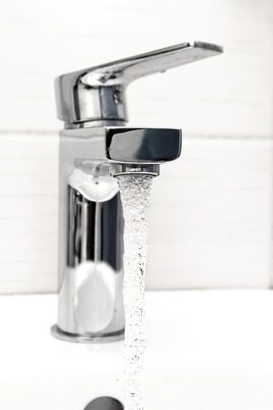 water tap with flowing water Stock Photo - 23859796