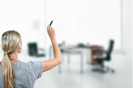 woman with black marker in the hand at the office photo