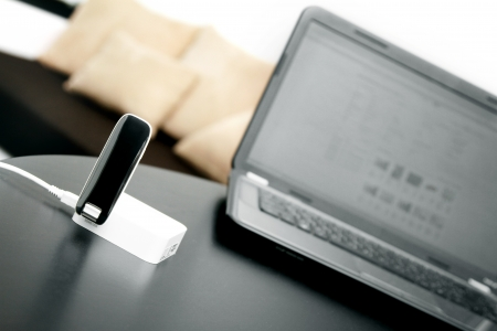 3g: mobile wireless internet router and laptop on the table