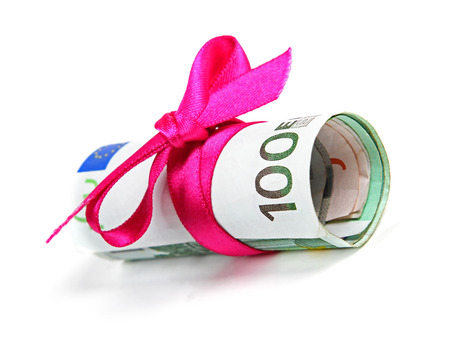 euro banknote: euro money roll gift with pink ribbon Stock Photo