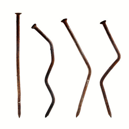 old rusty nails isolated on white photo