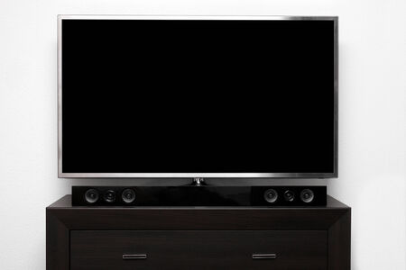 big screen tv: blank tv with stereo system on brown commode