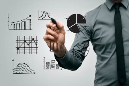 upward graph: business man drawing different graphs and charts Stock Photo