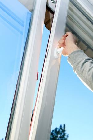 windows frame: hand open plastic window Stock Photo