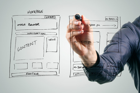 designer drawing website development wireframe