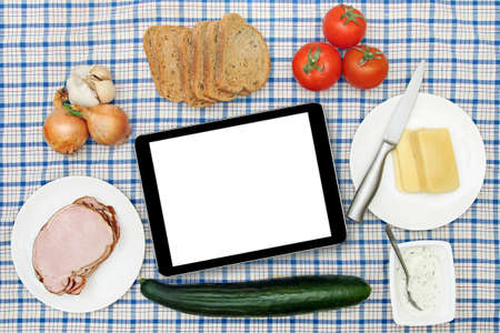kitchen table top: breakfast table with blank digital tablet in the center Stock Photo