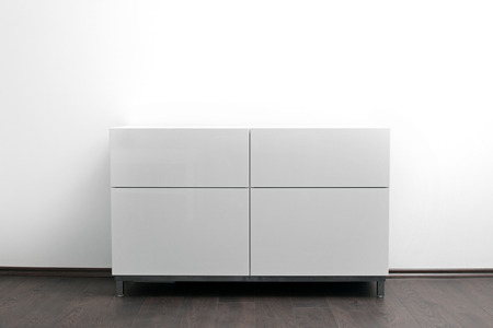 white chest of drawers in bright minimalism interior Stock Photo