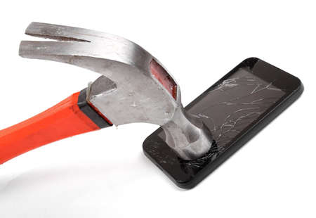 hammer and smartphone with smashed display Stock Photo