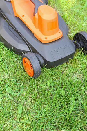 mow: electric lawnmower on green grass Stock Photo