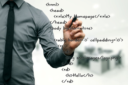 hypertext: website development - programmer writing html code