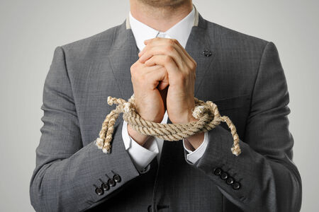 prisoner: businessman with a rope tied hands