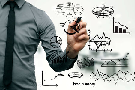 businessman drawing different graphs, charts and business elements photo