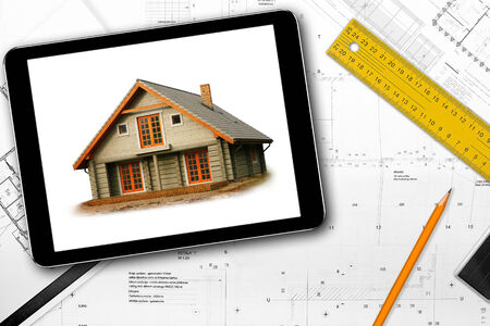 architect tools: digital tablet, tools and architect draft on the table