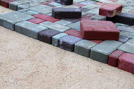 brick earth: gravel and colorful pavement bricks