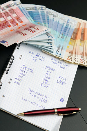 financial calculations and euro money. shadow economy concept photo