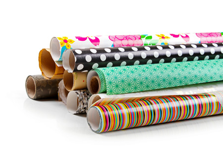 rolls of colorful wrapping paper isolated on white Stockfoto