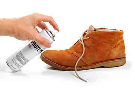 water shoes: mens suede shoe protection with spray Stock Photo