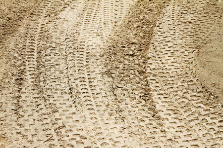 mud pit: tyre tracks in sand
