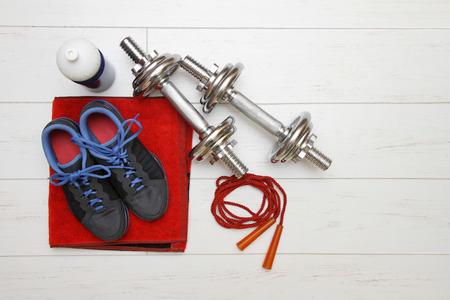fitness equipment on white wooden plank floor