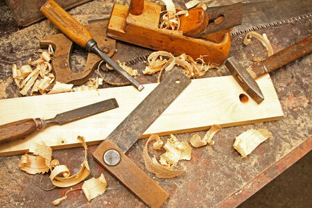 wood shavings: old vintage construction tools on the workbench