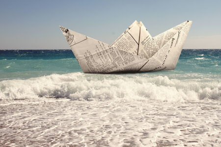 storm sea: paper boat floating in a sea Stock Photo