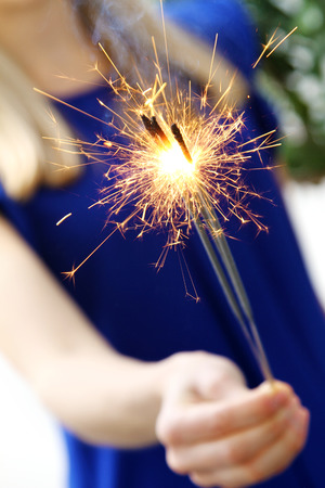 woman holding sparkler in her hand