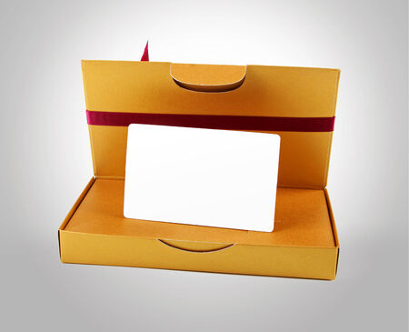 golden gift box with blank gift card inside photo