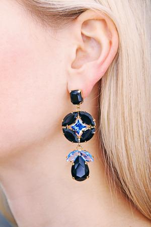 ear rings: closeup of earring on womans ear