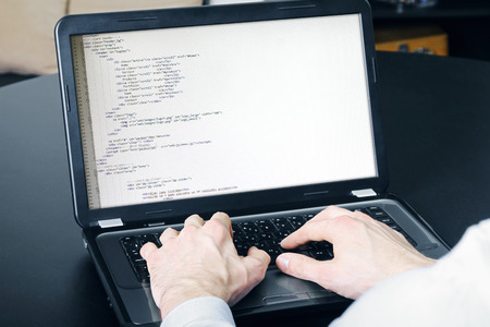 website development process - programmer writing code Stock Photo