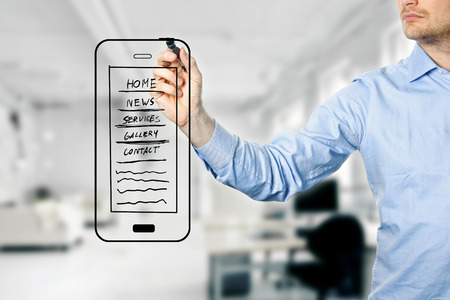development process: designer drawing mobile website development wireframe