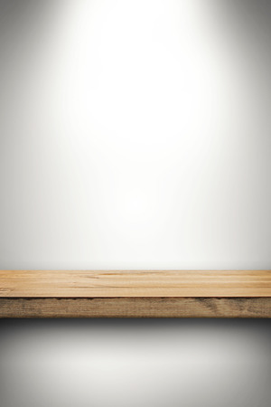 exhibition stand: empty wood shelf on white wall Stock Photo