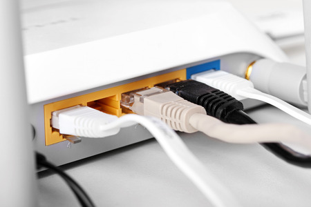 network port: close up of internet wireless router with plugged cables