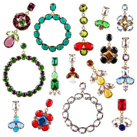 beautiful colorful crystal earrings collection isolated on white photo