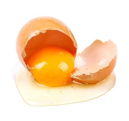 closeup of raw broken egg isolated on white Standard-Bild