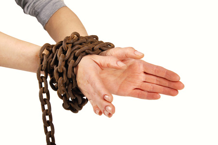 woman tied: hands tied with chain, isolated on white