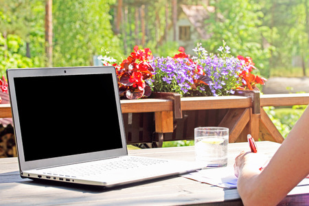 work from home, table with laptop on terrace Stock Photo