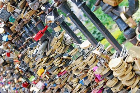 forever: lot of wedding padlocks on bridge railings, love forever concept Stock Photo