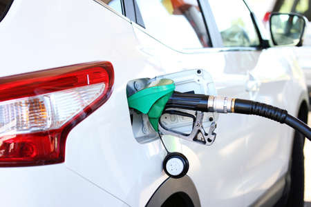 refilling: refilling the car with fuel in gas station Stock Photo